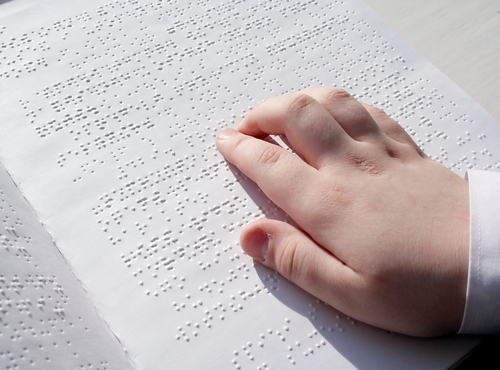 blind person writing